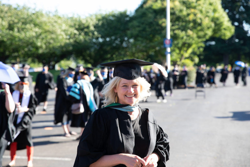 Professor Michelle Mallory is all smiles before Clark College's 2021 Commencement ceremony. Photo: Clark College/Tarek Kanso